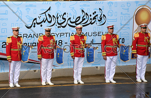 Long shot for military music squad wearing Military ceremony suites holding trumpets at the reception of  The Statue of King Ramses II at Grand Egyptian Museum in Cairo on 25 January 2018