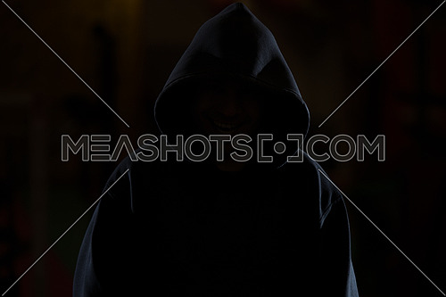 Young Man In Black Hooded Sweatshirt Invisible In The Night Darkness