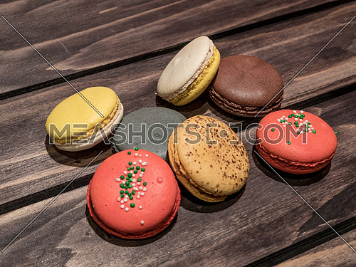 Colorful macaroons on dark background