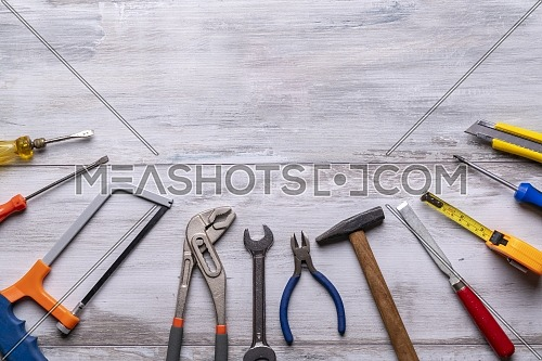 Screwdriver,hammer,tape measure and other tool for construction tools on rustic wooden background with copy space,industry engineer tool concept.still-life.