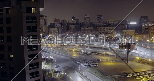 Drone Get up for 6 of October Bridge over Abd Elmonan Reyad Bus Station At Tahrir Area in cairo at night