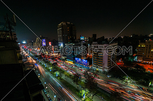 Long shot for traffic in Gameat Al Dowal Street at Cairo at Night