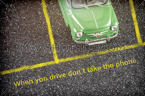 Road safety at the wheel, when driving do not take the mobile, conceptual image