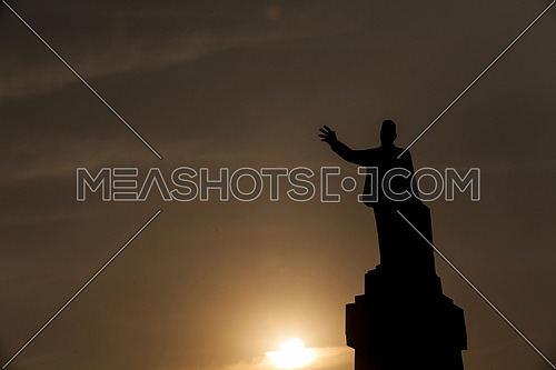 Long Sillhout Shot for Saad Zaghloul Statue at Cairo from Day to Sunset