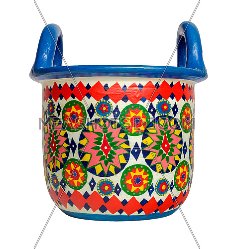 Handmade artistic pained colorful decorated pottery basket with two handles on white background isolated on white with clipping path