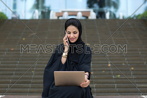 Businesswoman working in public and talking
