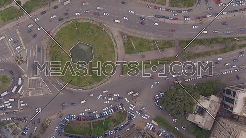 Fly Over top shot for Al Mohandseen area revealing Moustafa Mahmoud Square 22th of March 2018 in Giza  at day