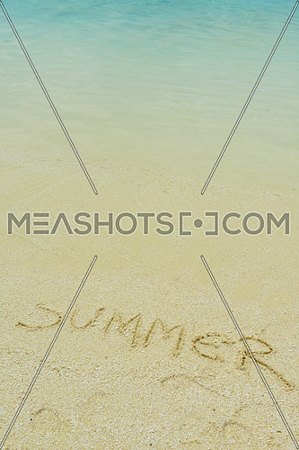 tropical beach nature landscape scene with white sand at summer with the word summer written on the sand