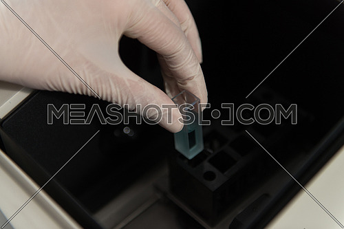 Close Up Of Female Scientist Hands Making Tests In Laboratory