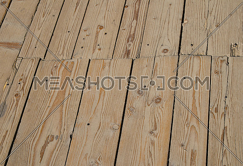 Old vintage rustic aged antique vivid wooden sepia surface with gaps in perspective