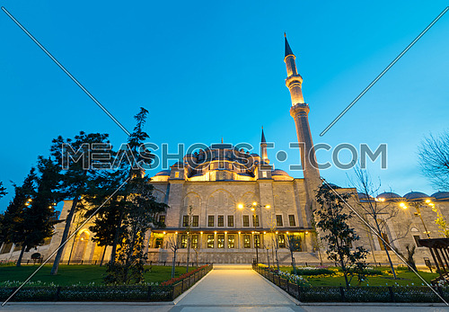 Exterior low angle night shot of Suleymaniye Mosque, an Ottoman imperial mosque located on the Third Hill of Istanbul, Turkey, and the second largest mosque in the city. built in 1557