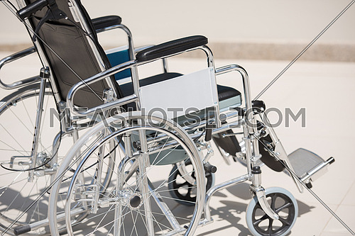 wheelchair in front of a modern clinic
