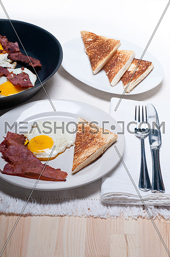 eggs sunny side up with bacon and toast typical english breakfast