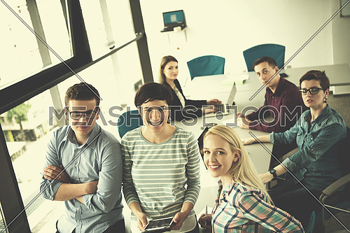 group of business people preparing for next meeting and discussing ideas using digital tablet