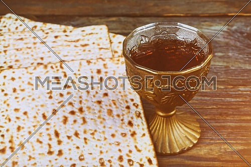 Pesach Passover symbols of matzo and wine in glass. Retro style