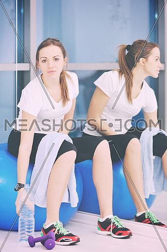 young woman drink water at fitness workout training at sport club