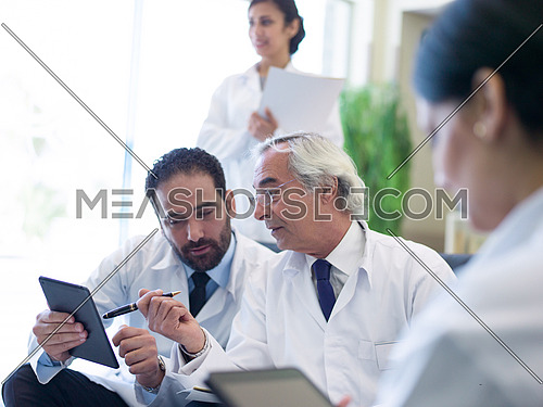 medical staff in meeting together in hospital