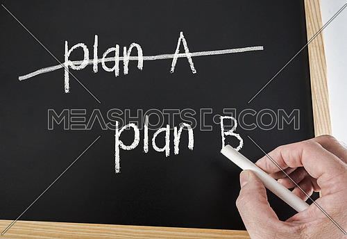 Crossing out Plan A and writing Plan B, conceptual image