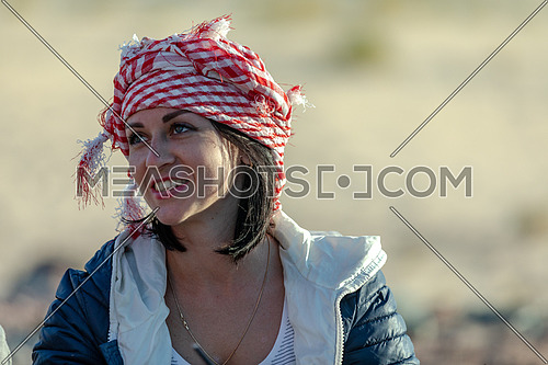 Close up for female tourist wearing bedouin traditions headscarf at Ain hodouda in Sinai at day