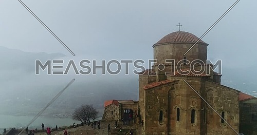 Jvari Monastery by drone during a foggy day