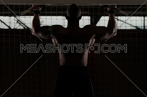 Bodyubilder Doing Pull Ups - Chin-Ups In The Gym