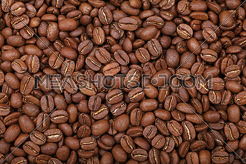 Roasted brown Arabica coffee big beans background pattern, close up, elevated top view