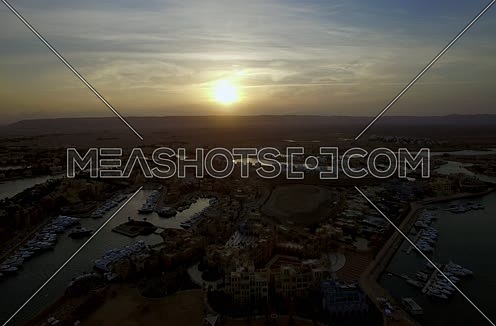 Drone shot flying above Al Gouna Marina  at sunset