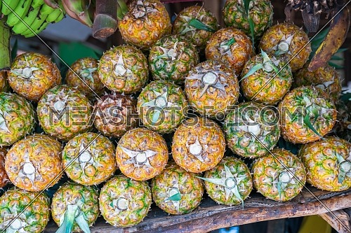 Pineapple stack at grocery on tropical marketplace outdoor,Samana peninsula,Dominican republic.