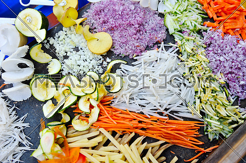 fresh healthy organic food mixed vegetables slice on black background