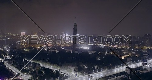 Aerial shot flying towards Cairo Tower at night
