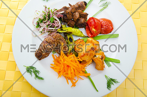 Plate with tasty lamp kebabs