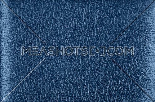 Close up background texture pattern of indigo blue natural leather grain, directly above
