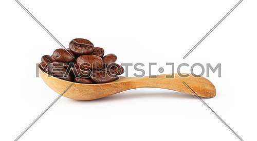 Close up wooden scoop spoon full of roasted Arabica coffee beans isolated on white background, low angle side view