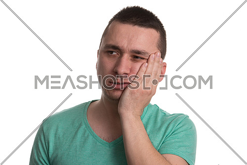 Portrait Of Young Man With Sensitive Tooth Ache Crown Problem , Suffering From Pain, Touching Outside Mouth With Hand, Isolated On White Background