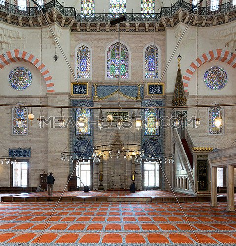 Istanbul, Turkey - April 19, 2017: Few people praying at Suleymaniye Mosque, an Ottoman imperial mosque built in 1557, located on the Third Hill of Istanbul, Turkey, and the second largest mosque in the city