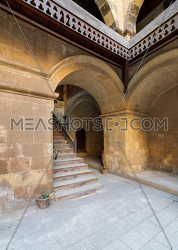 Exterior daylight shot of staircase going up leading to Caravansary - Wikala - of Bazaraa, suited in Gamalia district, Medieval Cairo, Egypt