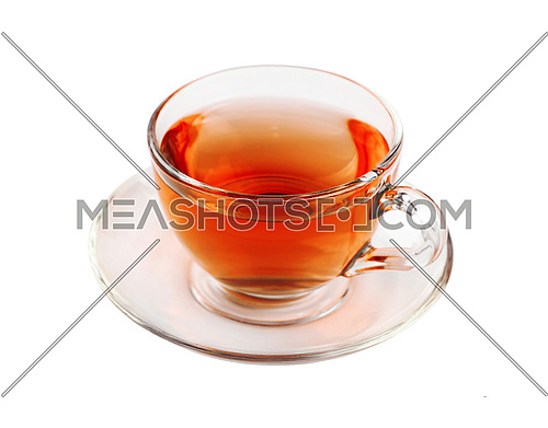 Close up one transparent glass cup of black tea on saucer isolated on white background, high angle view