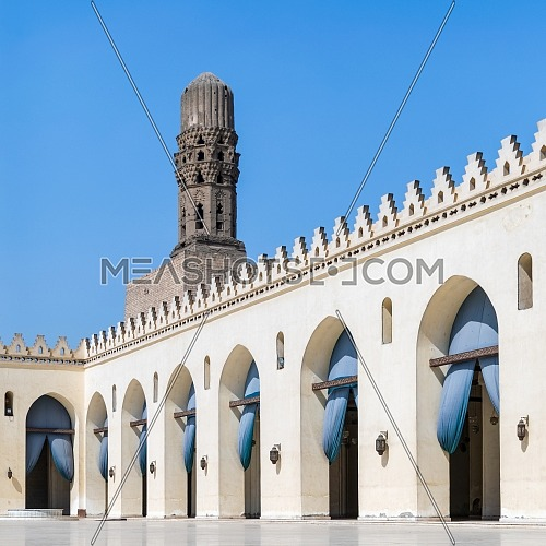 Minaret of public historic Al Hakim Mosque known as The Enlightened Mosque, located in Moez Street, south of the old door of old Cairo gate named Bab Al-Futuh, Egypt