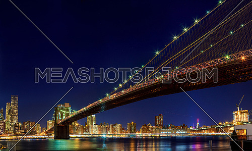 New york city Brooklyn bridge - downtown at night Hudson River with skyline after sunset night view illuminated