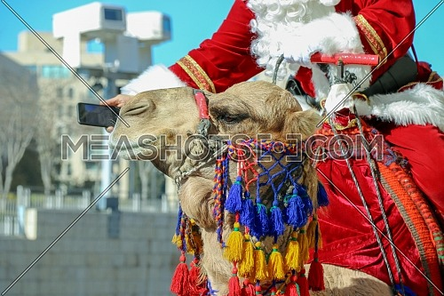 Christmas celebrations in Jerusalem, Santa Claus distributes gifts under the walls of Jerusalem at the Jaffa Gate