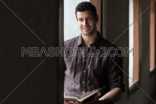 Humble Muslim Man Is Reading The Koran In The Mosque