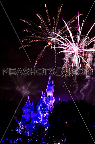 fireworks bursts up top Disney Land Castle, The happiest Place on earth, closing ceremony. 2016
