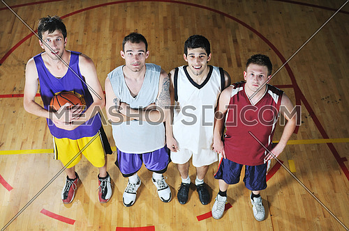 basket ball players team portrait in hi-school sport gymbasket ball players team portrait in hi-school sport gym