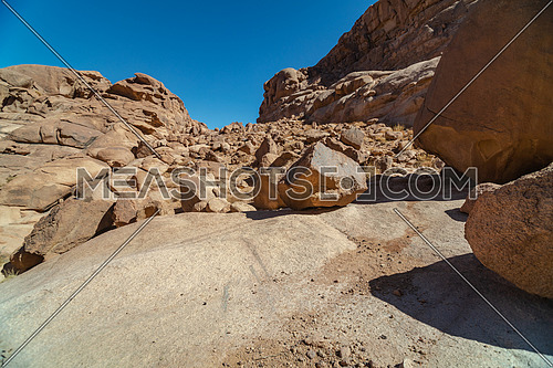 Mid shot for rocks at Ain Hardra at Sinai Mountain at day.
