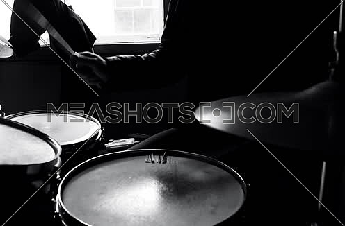 Drummer In Studio Playing Drums black and white