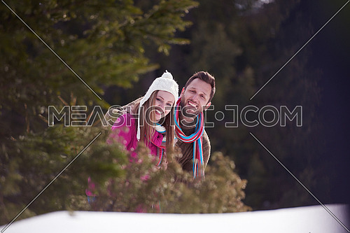 portrait of happy young romantic tourist  couple outdoor in nature at winter vacation