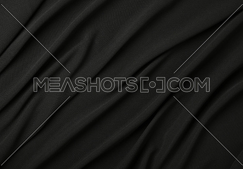 Close up abstract textile background of black folded pleats of fabric, elevated top view, directly above