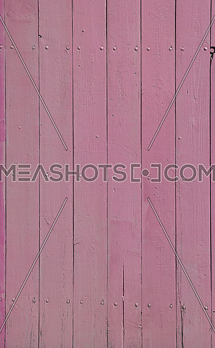 Close up background texture of pink vintage painted wooden planks, rustic style wall panel