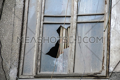 close up shot for old window with broken glass