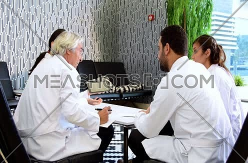 a group of  middle eastern doctors meeting and discussing with team